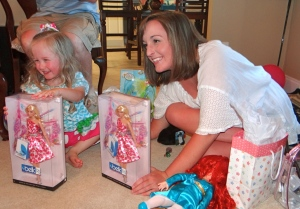 One of my aunts and her family was on the ball, because I got an early birthday present too! Emily and I both got the gorgeous Belk commemorative Barbie doll! Emily didn't like the idea of keeping it in the box... She conned her daddy into helping her open it when Mommy wasn't home ;)