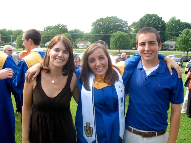 Just hangin' with (and on, apparently) two of my favorite people after my graduation ceremony