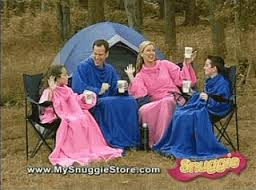 My all-time fave Snuggie commercial picture... Mom is shamelessly raising the roof in her Snuggie while holding a coffee mug... Priceless.